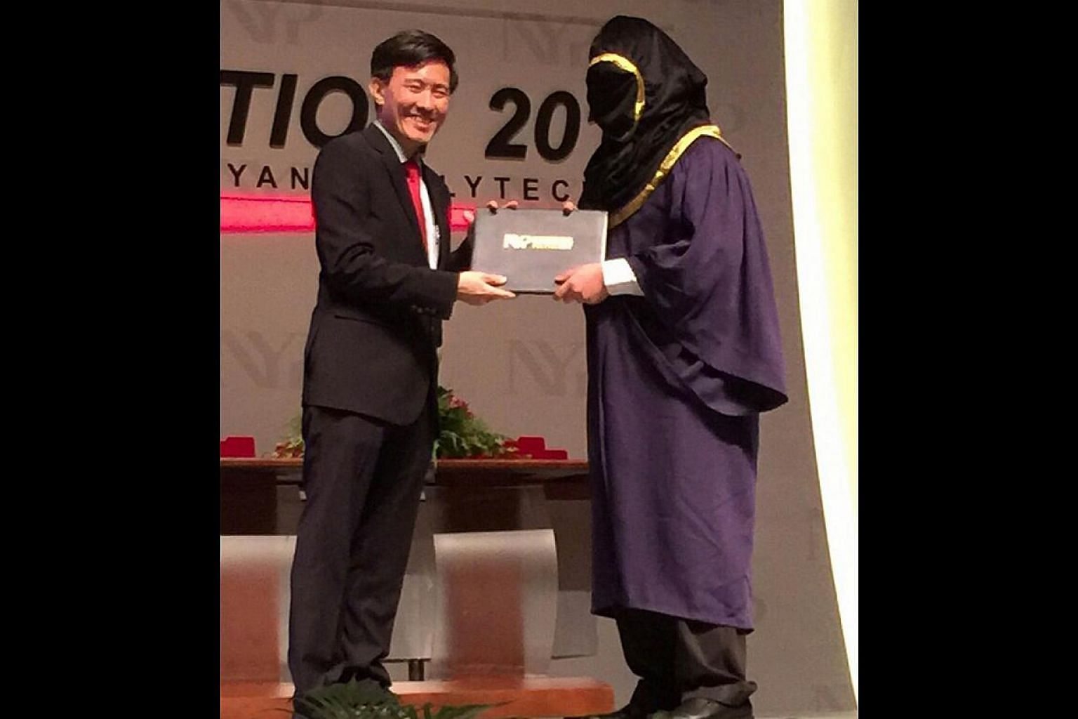 A student from Nanyang Polytechnic turned up for his convocation ceremony last week with a hood covering his entire face. -- PHOTO:SHIN MIN DAILY NEWS