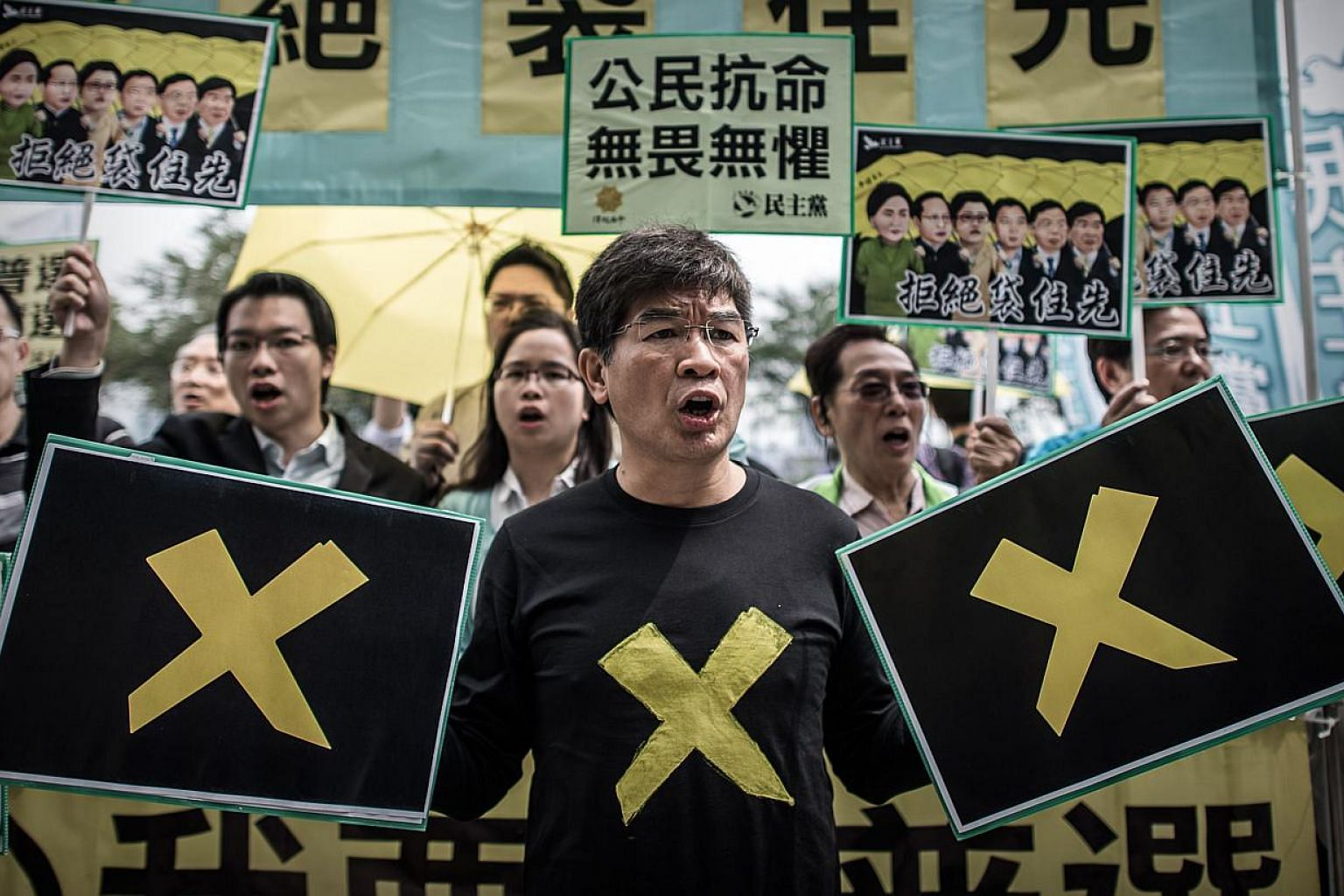 Pro-democracy demonstrators stage a protest outside the government building in Hong Kong on April 22, 2015. -- PHOTO: AFP