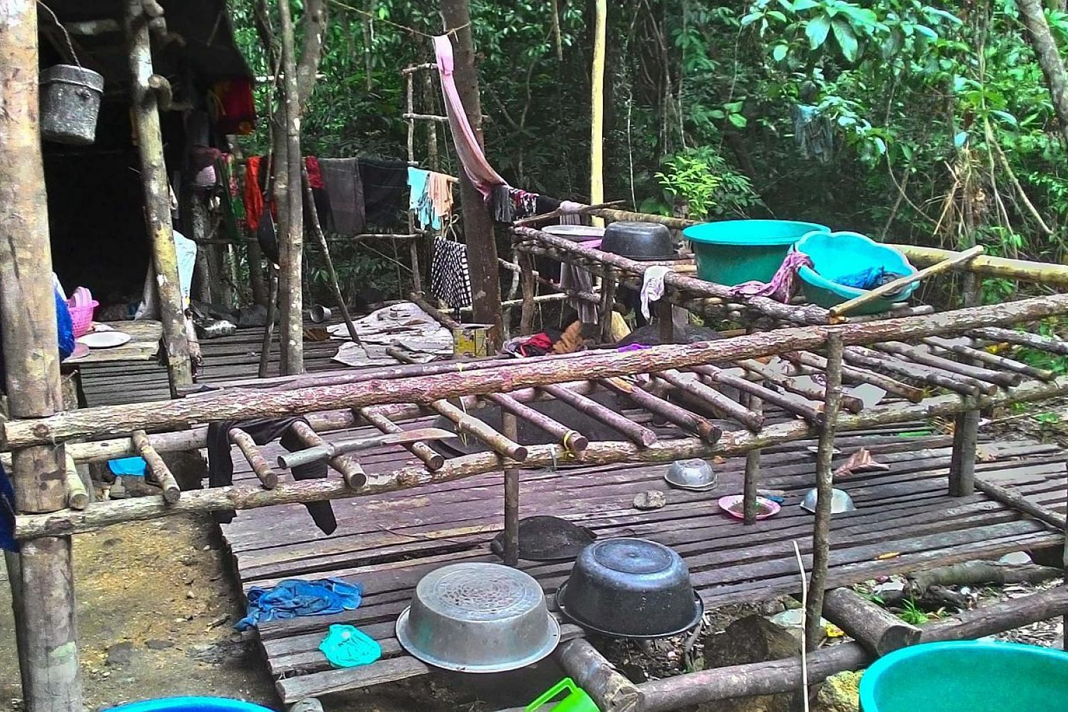 An abandoned migrant detention camp used by people smugglers in a jungle near the Malaysia-Thailand border. From May 11 to last Saturday, police personnel searched an area spanning 49.5km.