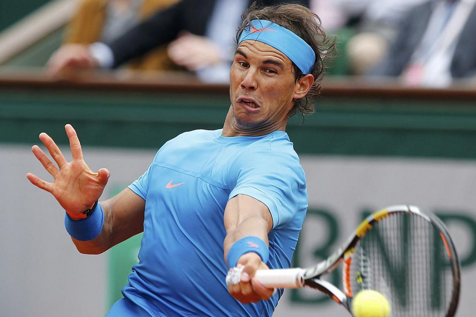 Rafael Nadal of Spain plays a shot to Quentin Halys of France during their men's singles match at the French Open tennis tournament at the Roland Garros stadium in Paris, France on May 26, 2015. -- PHOTO: REUTERS