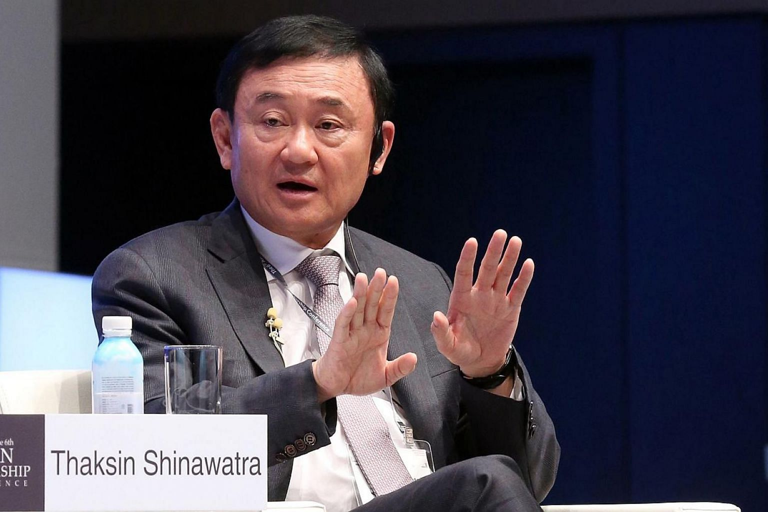 """Former premier Thaksin Shinawatra speaking at the Asian Leadership Conference in Seoul on May 19, 2015. Thailand's foreign ministry on Wednesday, May 27, said it had cancelled the fugitive former premier's passports because he was deemed to have """"end"""