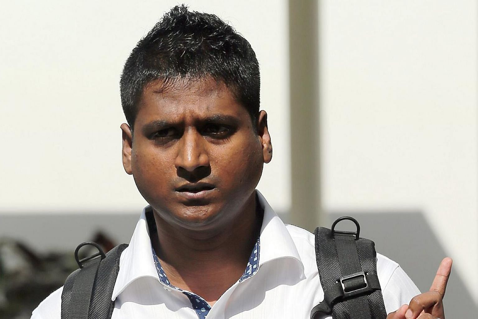 Arun Kaliamurthy, an Indian national who has a master's degree in information systems and was looking for a job here, had claimed trial to a single charge of failing to disperse from the scene despite police orders to do so. -- ST PHOTO: WONG KWAI CH