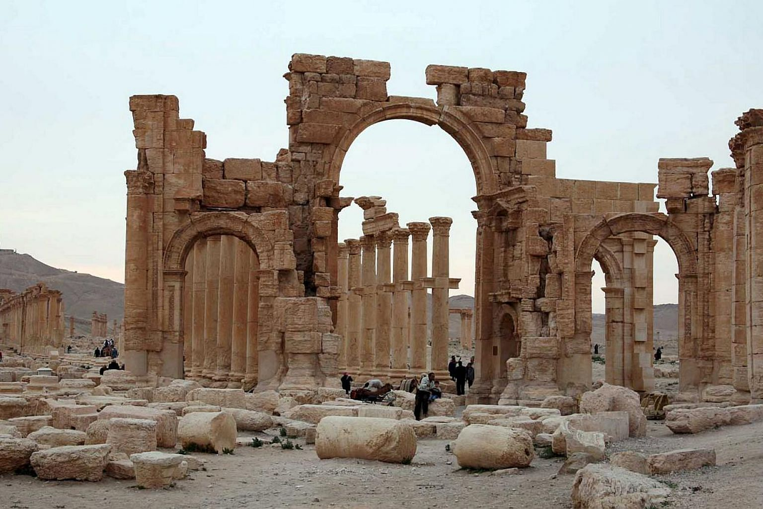 Tourists walk in the historical city of Palmyra, on April 14, 2007.Militants from the Islamic State in Iraq and Syria (ISIS) on Thursday, May 28, 2015, have posted photographs online which it said were taken in the central Syrian city of Palmyr