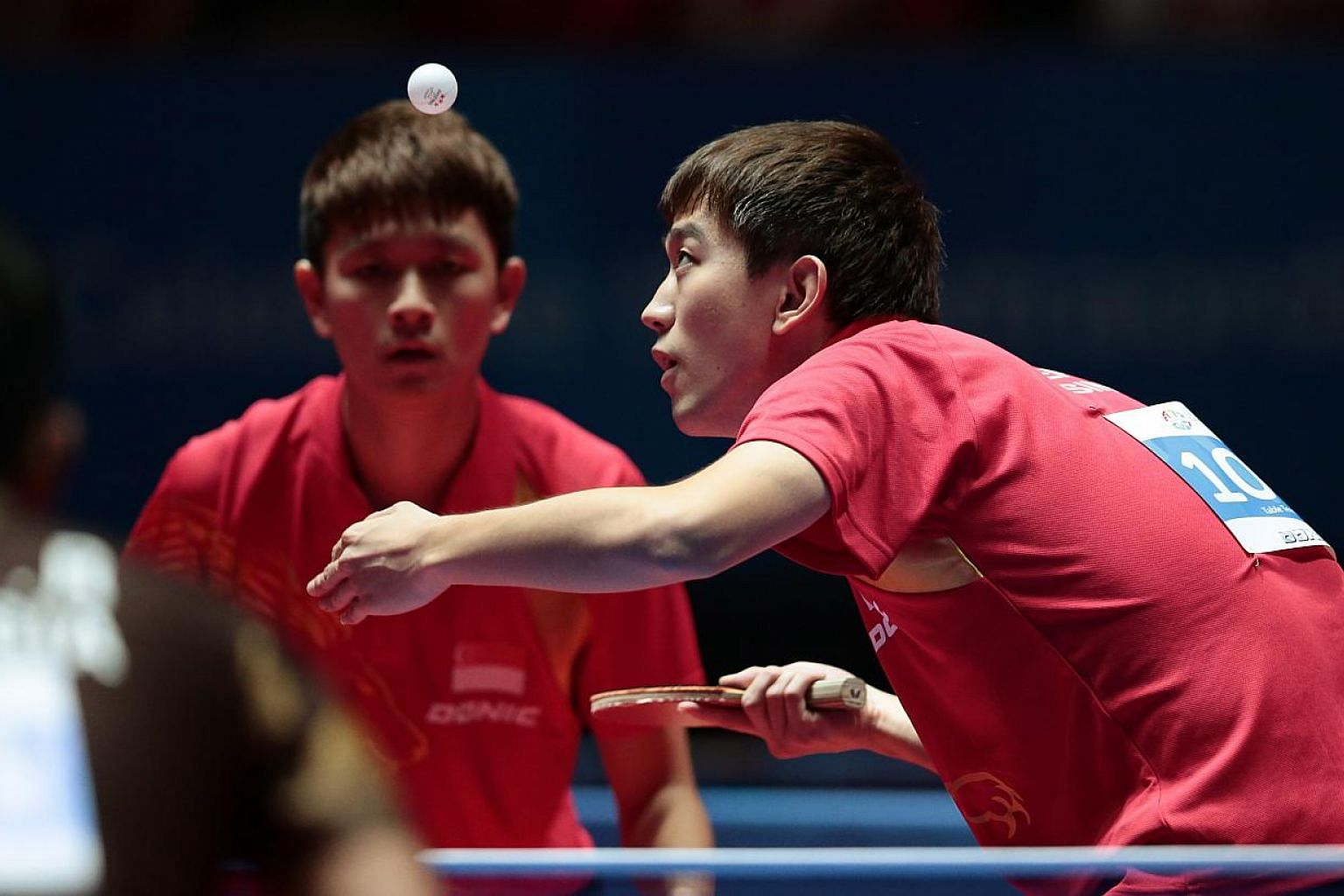Singapore's Chen Feng (right) and Chew Zhe Yu Clarence in action at the SEA Games 2015. The Republic paddlers are on course for all-Singapore finals in both the SEA Games men's and women's doubles competitions, as all four pairings progressed into se