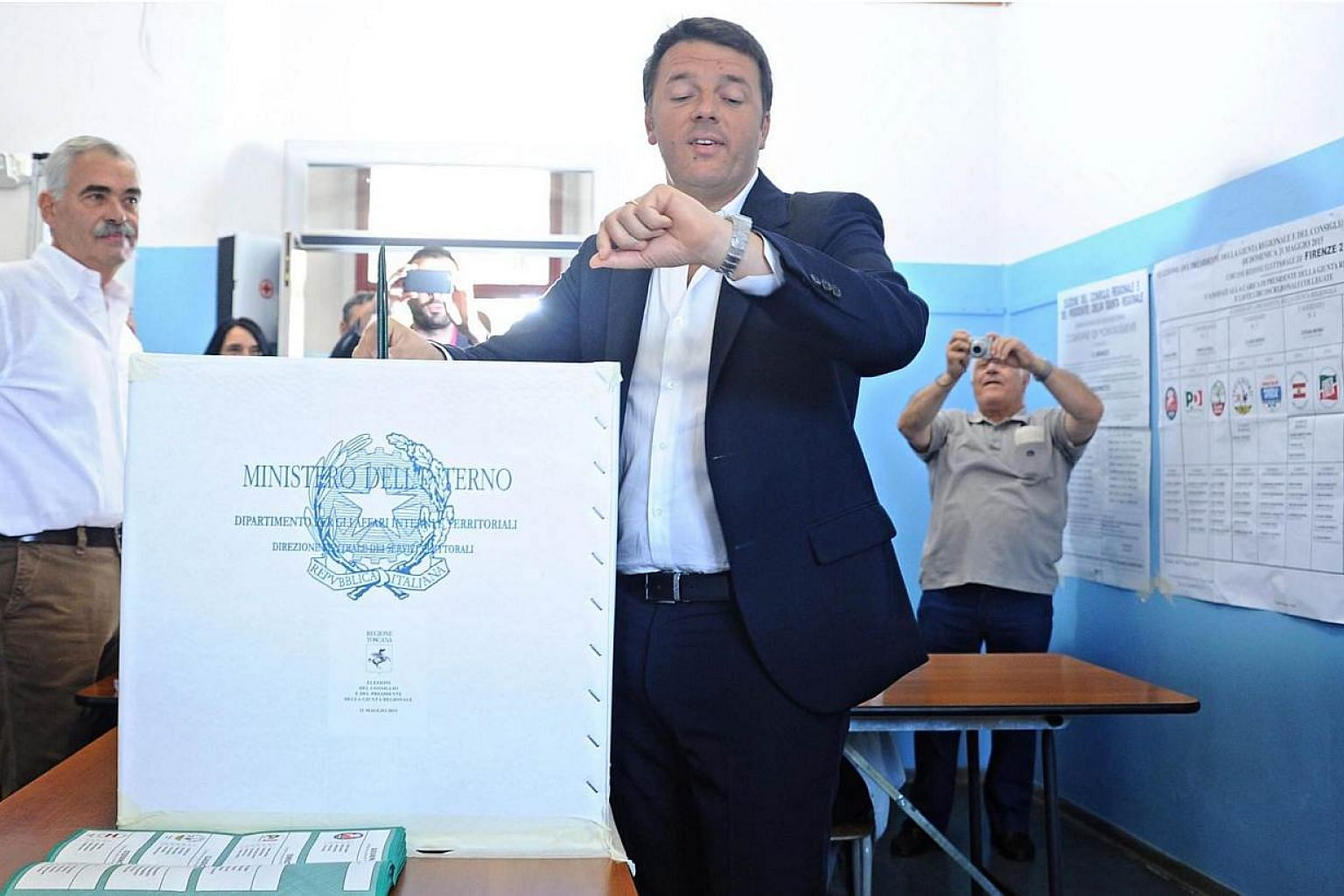 Italian Premier Matteo Renzi casts his ballot at a polling station in Pontassieve, near Florence, Italy, on May 31, 2015.Mr Renzi was left licking his wounds on Monday, June 1, after suffering a setback in regional elections which saw both the