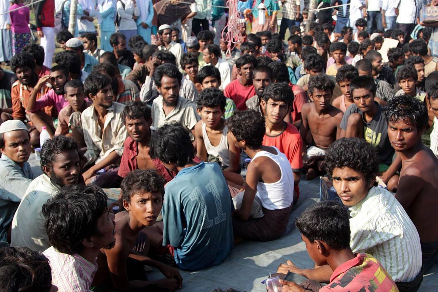 Refugees from Myanmar and Bangladesh are seen in a camp after their rescue by Aceh fisherman in Julok, East Aceh, Sumatra, Indonesia, on May 20, 2015. - PHOTO: AFP