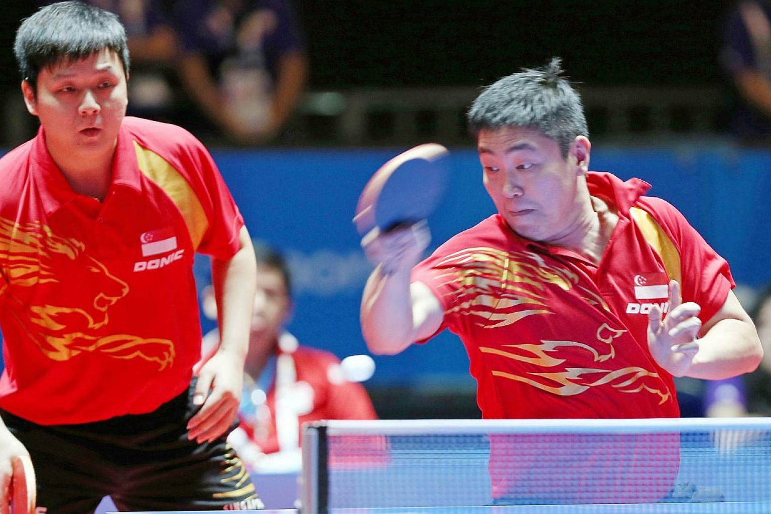 Favourites Gao Ning (right) and Li Hu beat Thailand's Tanviriyavechakul Padasak and Udomsilp Chanakarn in the table tennis men's doubles final to make it two gold medals for Singapore at the 28th SEA Games on Tuesday night . -- ST PHOTO: SEAH KWANG P