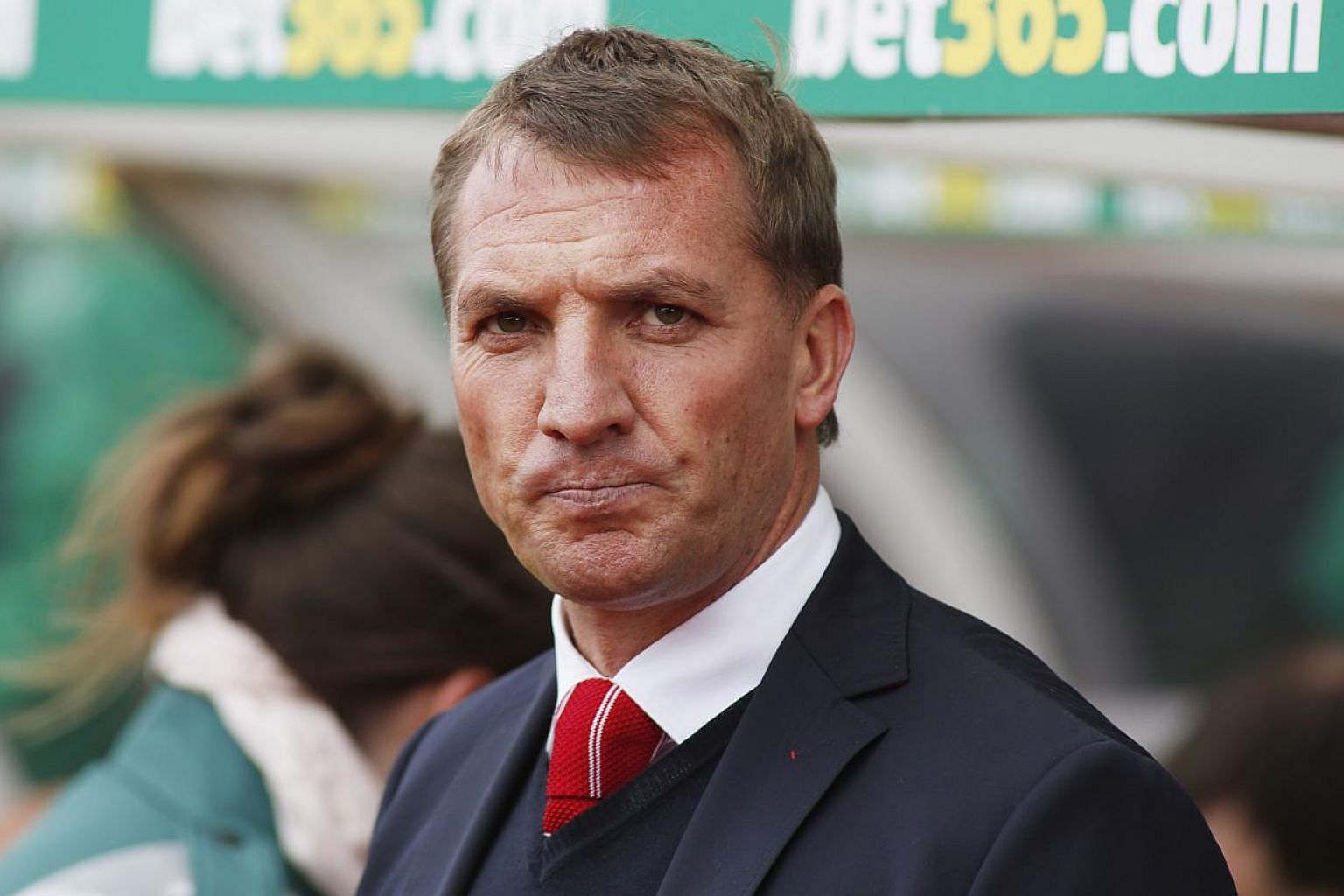 Brendan Rodgers will be given another chance to deliver Liverpool their first league title in over a quarter of a century after he held talks with the club's American owners on Tuesday both the Press Association and the BBC reported. -- PHOTO: REUTER