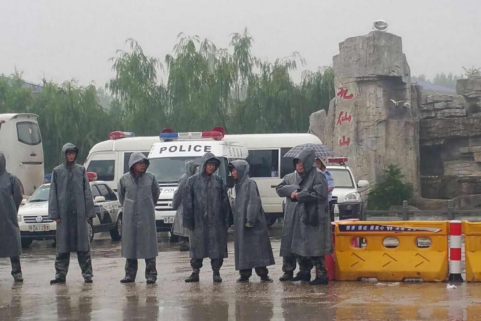 A police cordon outside the Rongcheng crematorium in Jianli county, Hubei province. Members of the media were barred from entering the premises. -- ST PHOTO: KOR KIAN BENG