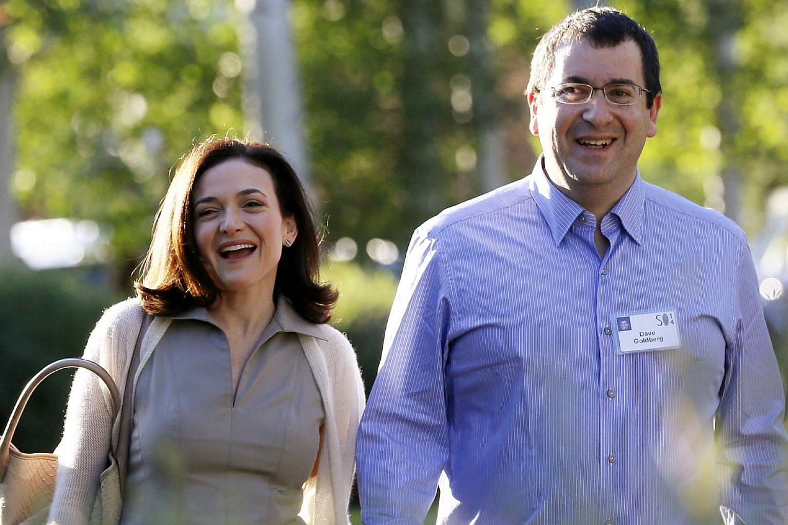 Chief Operating Officer (COO) of Facebook Sheryl Sandberg (left), with her husband David Goldberg, CEO of SurveyMonkey, at a media conference in Sun Valley, Idaho on July 9, 2014. -- PHOTO: REUTERS