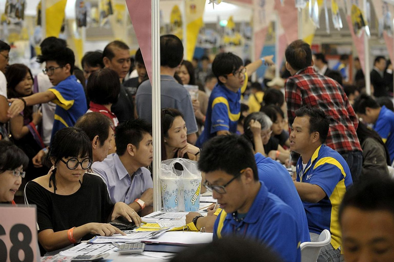 Visitors at the Chan Brothers booth at the Natas 2012 travel fair held at the Singapore Expo. -- PHOTO: ST FILE