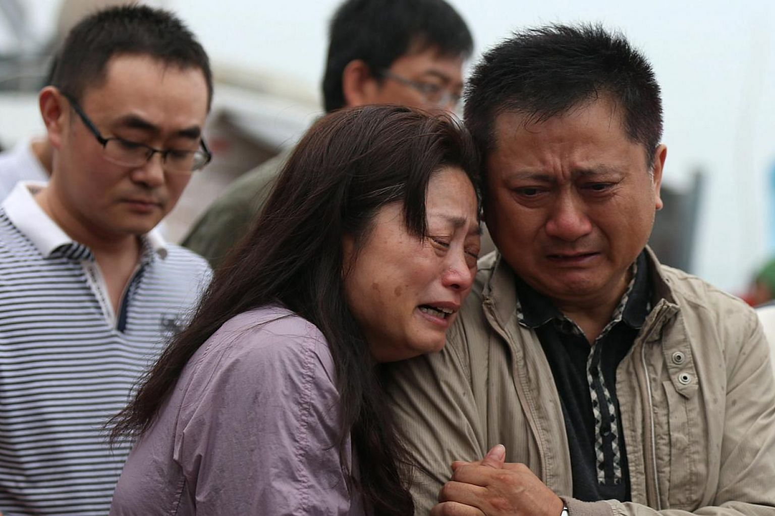 Relatives of passengers missing in the sinking of a cruise ship on the Yangtze River have accused Chinese police of beating them when they sought more information on the disaster. -- PHOTO: EPA