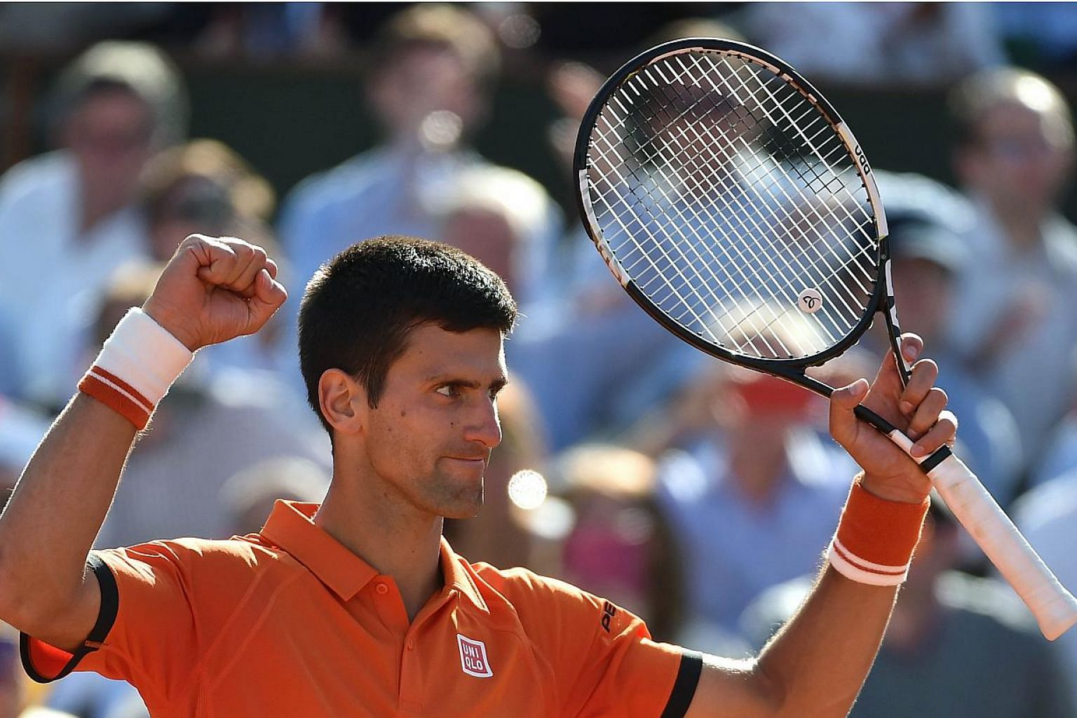 Serbia's Novak Djokovic celebrates his victory over Spain's Rafael Nadal at the end of their men's quarter final match of the Roland Garros 2015 French Tennis Open in Paris on June 3, 2015. -- PHOTO: AFP