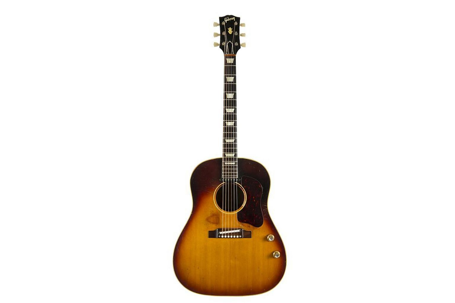 The jumbo J-160E Gibson Acoustic guitar, purchased by Lennon in Liverpool, is expected to fetch between US$600,000 and US$800,000 (S$1,079,000) when it goes on sale on Nov 6 at an auction of rock'n'roll memorabilia in Beverly Hills. -- PHOTO: REUTERS