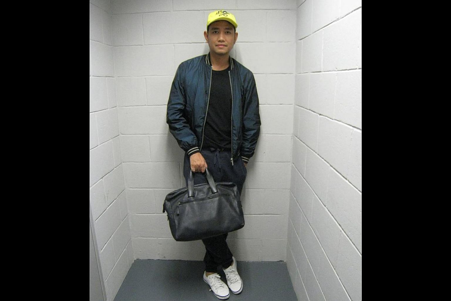 HIS BAG: Lanvin bag. It can pass as a business bag, and it is also soft and good for use on a casual day. The design is clean and simple, which is what I like in leather products. -- ST PHOTOS: SAMANTHA GOH