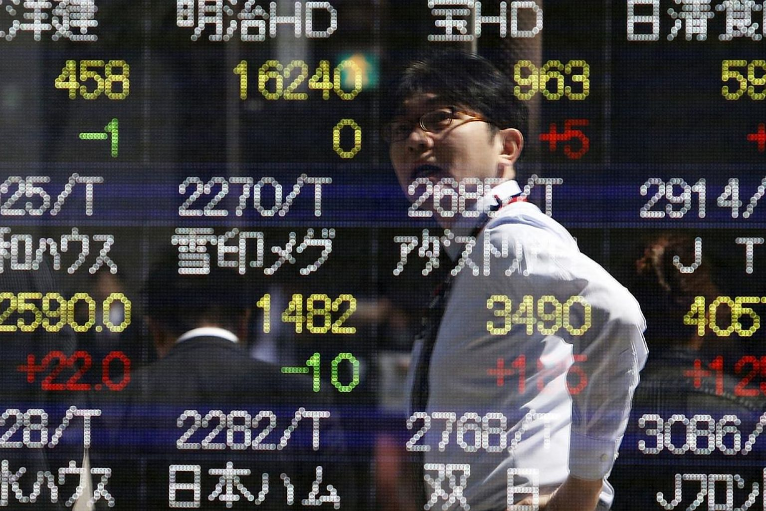 Asian stocks fell for a fifth day, with the regional benchmark index heading for its second week of losses, following a decline in United States equities as Greece asked for a deferral on its debt payments. -- PHOTO: REUTERS