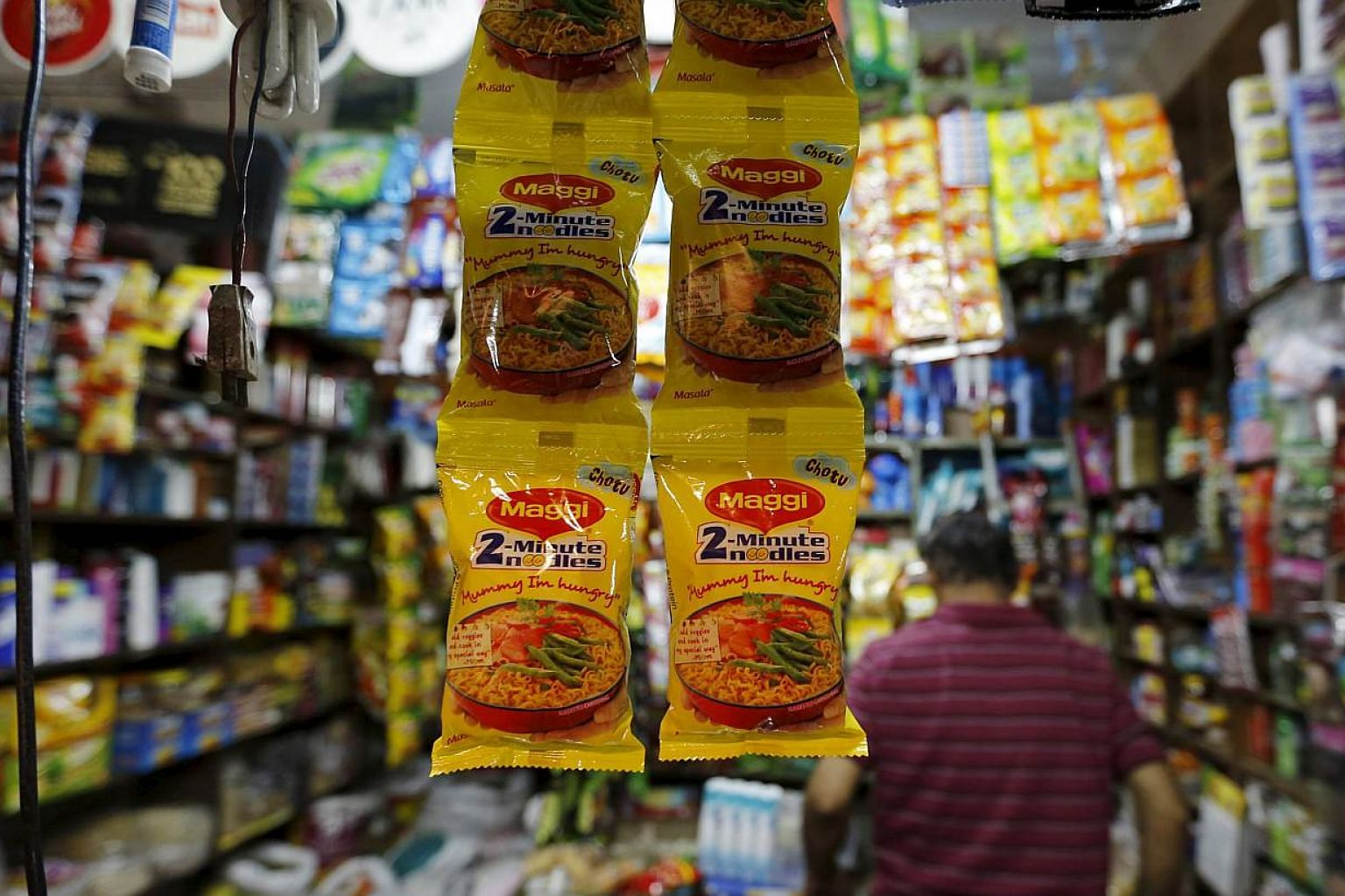 Packets of Maggi instant noodles are seen on display at a grocery store in Ahmedabad, India, on June 3, 2015.India's food safety regulator said on Friday that laboratory tests had found overwhelming evidence that Nestle India's instant noodle p