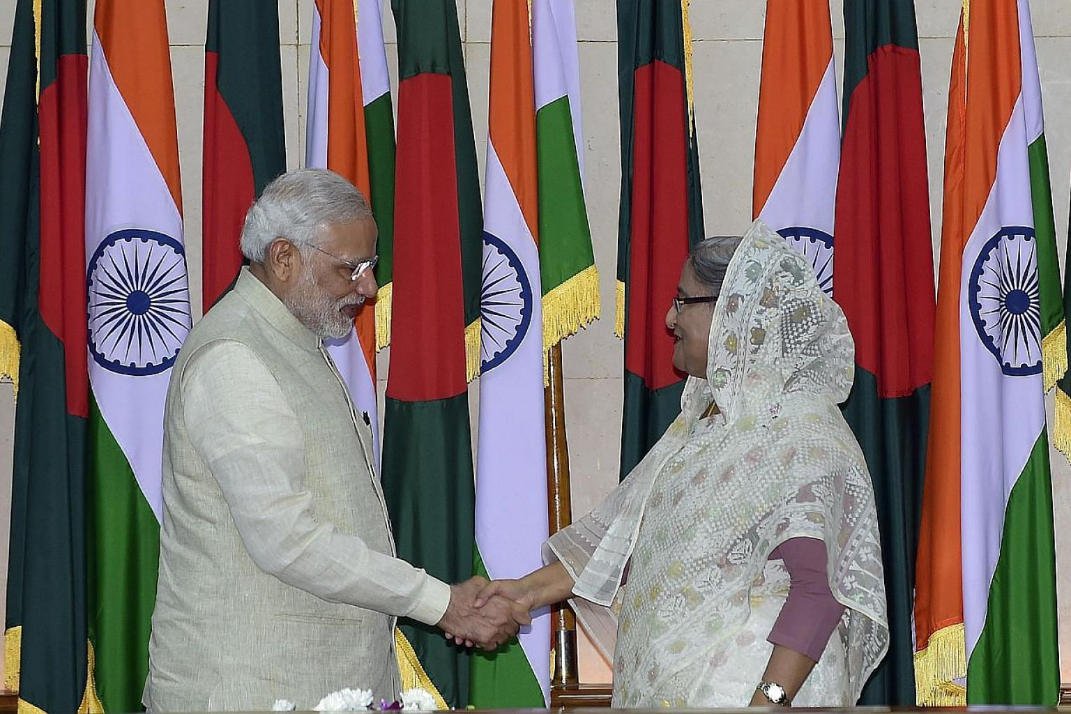 Indian Prime Minister Narendra Modi (left) shakes hand with Bangladeshi Prime Minister Sheikh Hasina Wajid after their meeting at the Prime Minister's Office in Dhaka on June 6, 2015. The two neighbours signed a historic pact on Fridayto simpli