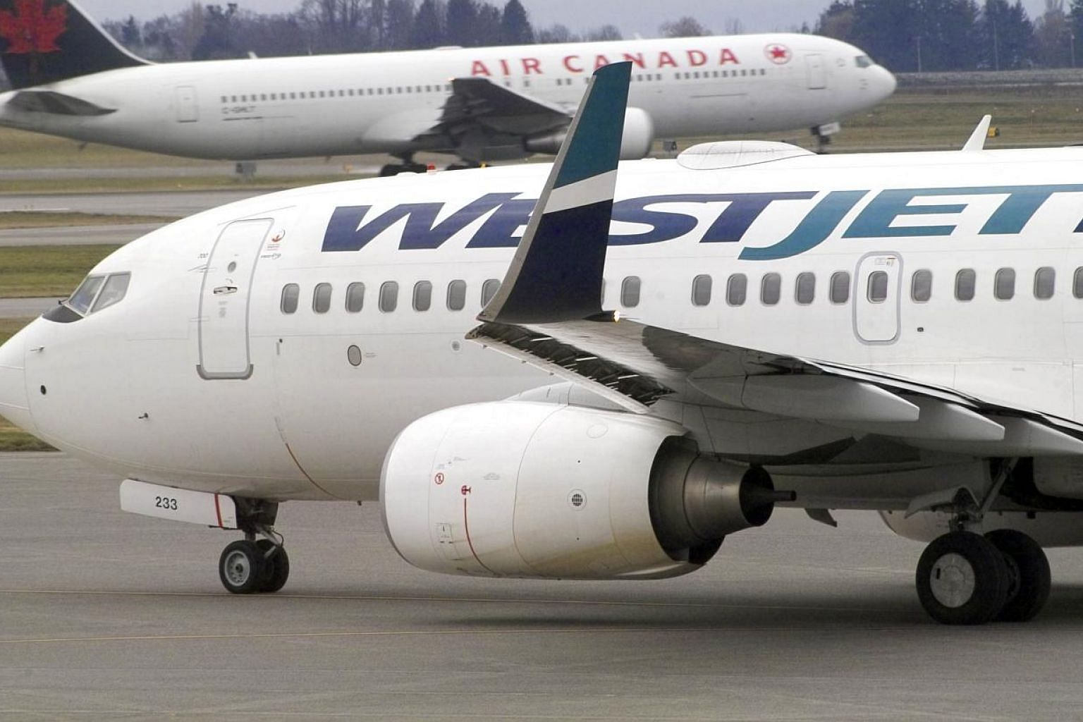 A Canadian domestic Westjet flight from Toronto skidded off the end of a runway at Montreal airport during a thunderstorm on Friday, June 5, 2015, but no injuries were reported. -- PHOTO: BLOOMBERG