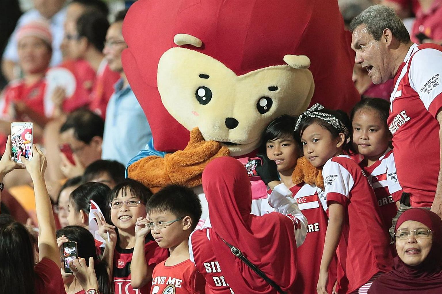SEA Games mascot Nila posing with fans during the football match between Singapore and Philippines at the Jalan Besar Stadium on June 1, 2015. -- PHOTO: REUTERS