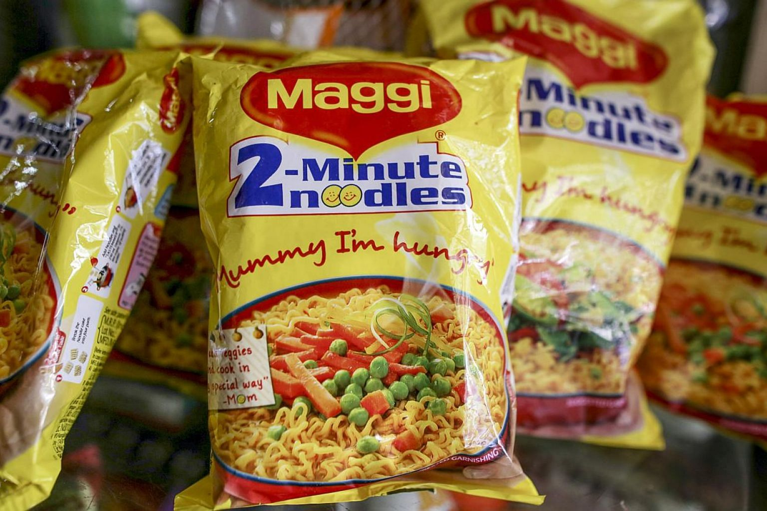 Packets of Maggi noodles, manufactured by Nestle India, are seen at a general store in Mumbai on June 2, 2015. The India-made noodles are safe to eat, the Agri-Food and Veterinary Authority of Singapore said on Monday night. -- PHOTO: BLOOMBERG