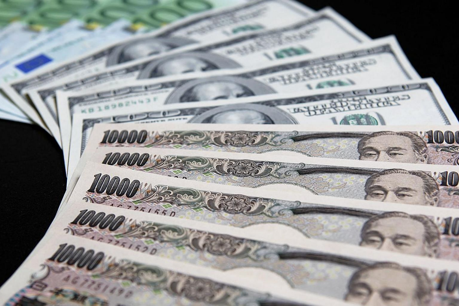 """The Japanese yen surged against the dollar and the euro on Wednesday after the head of the Bank of Japan said a further slide in the Japanese currency was """"unlikely"""". -- PHOTO: BLOOMBERG"""