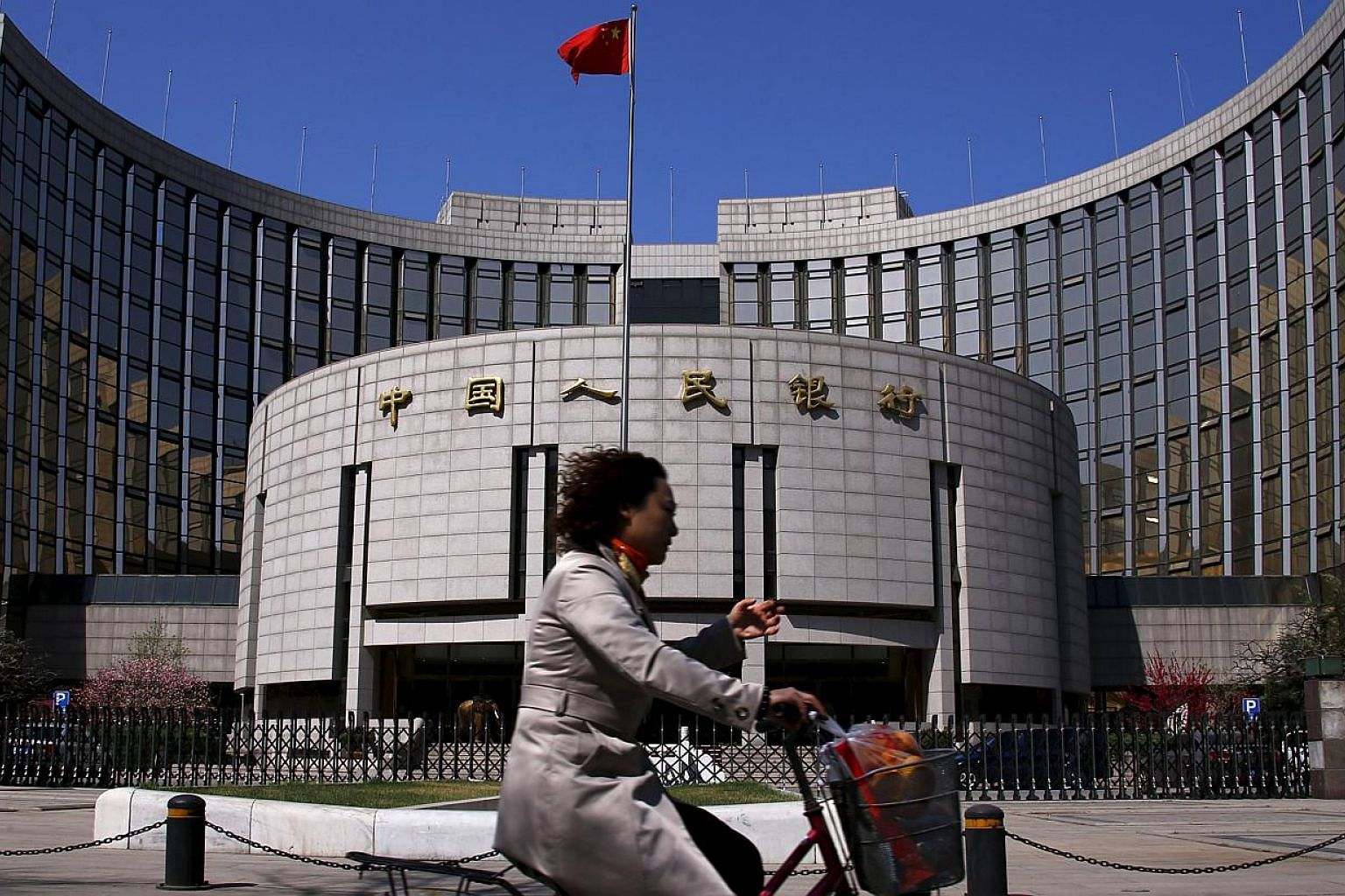 The People's Bank of China may lower the amount lenders must set aside as reserves by as much as 100 basis points this weekend to 17.5 per cent, making it the third reduction this year. -- PHOTO: REUTERS
