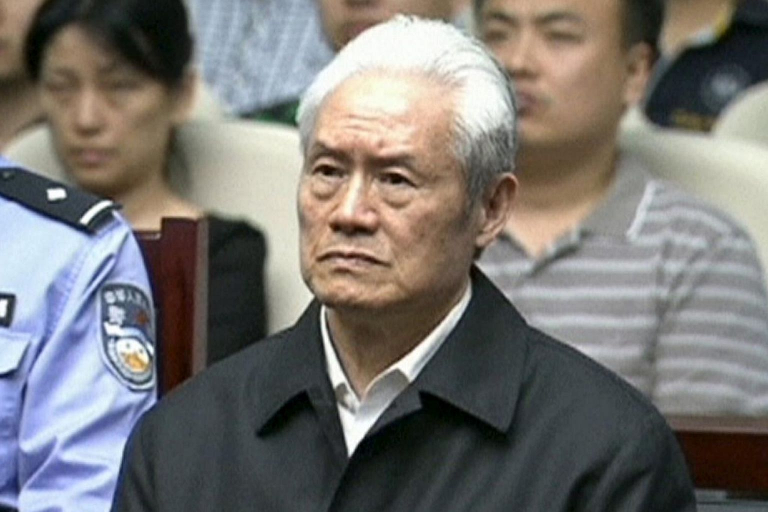 Zhou Yongkang, China's former domestic security chief, attends his sentence hearing in a court in Tianjin, China, in this still image taken from video provided by China Central Television and shot on June 11, 2015. -- PHOTO: REUTERS
