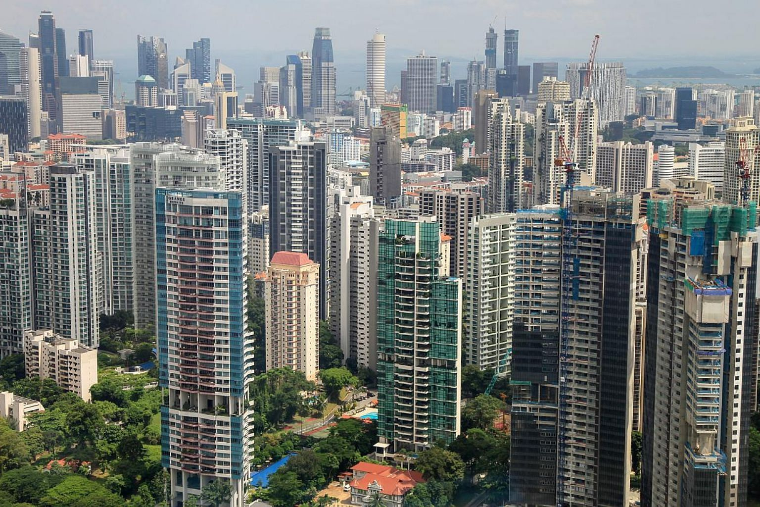 Residential buildings stand in the Grange Road area of Singapore. Buyers with HDB addresses are opting for smaller apartments when they venture into the private housing market, according to DTZ Research. -- ST PHOTO: BLOOMBERG