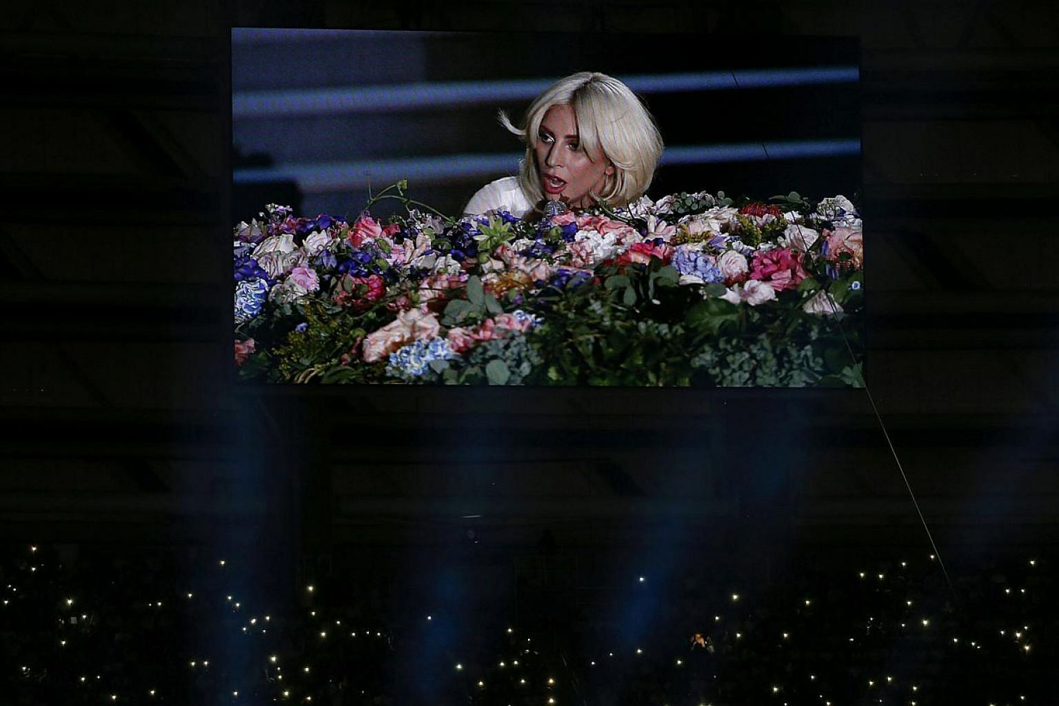 Singer Lady Gaga is displayed on a videowall while fans light their phones during the opening ceremony of the 1st European Games in Baku, Azerbaijan, June 12 , 2015. -- PHOTO: REUTERS