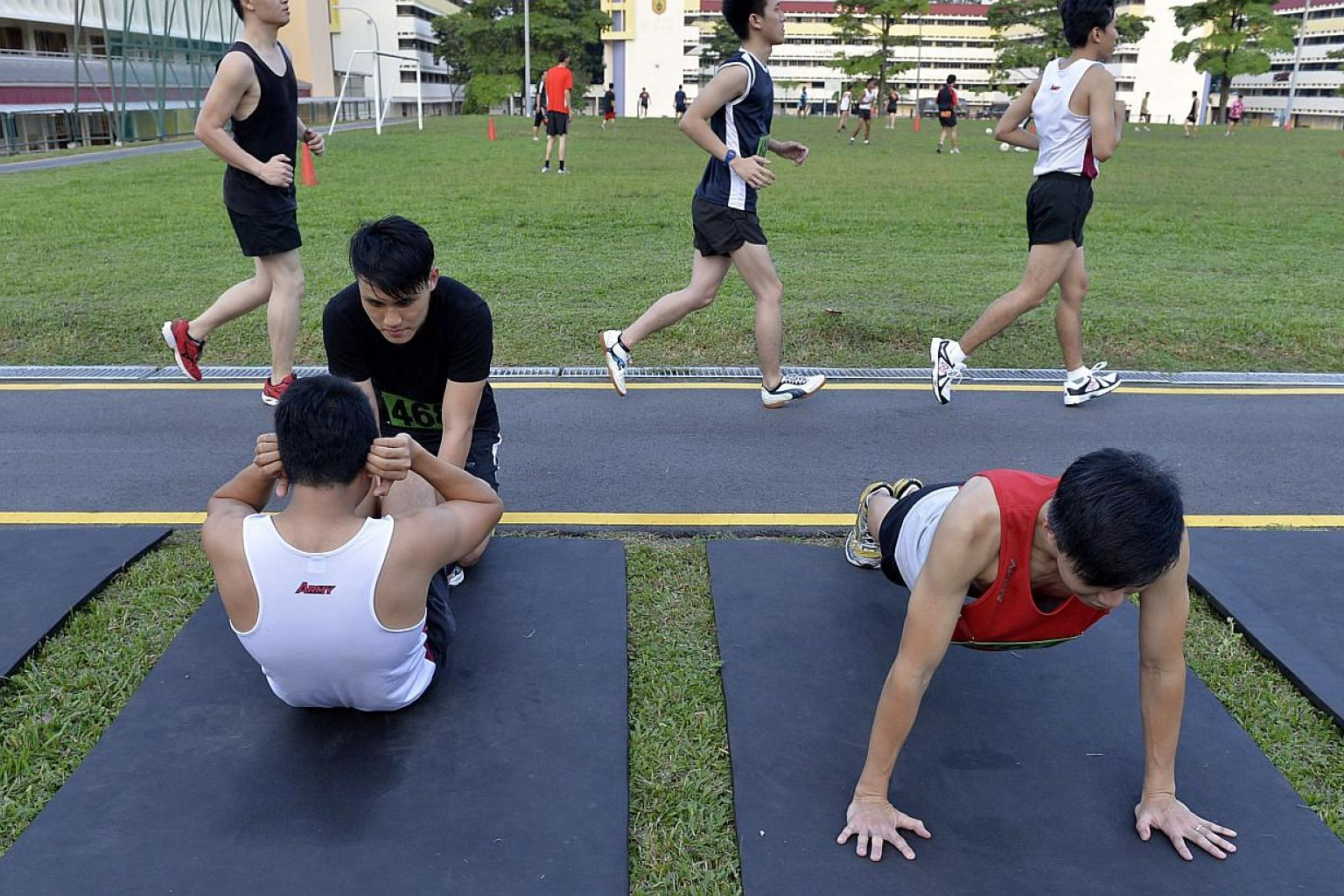 The Singapore Armed Forces (SAF) has shelved boot camp plans for reservist servicemen who skip their mandatory military fitness test three times. -- PHOTO: ST FILE