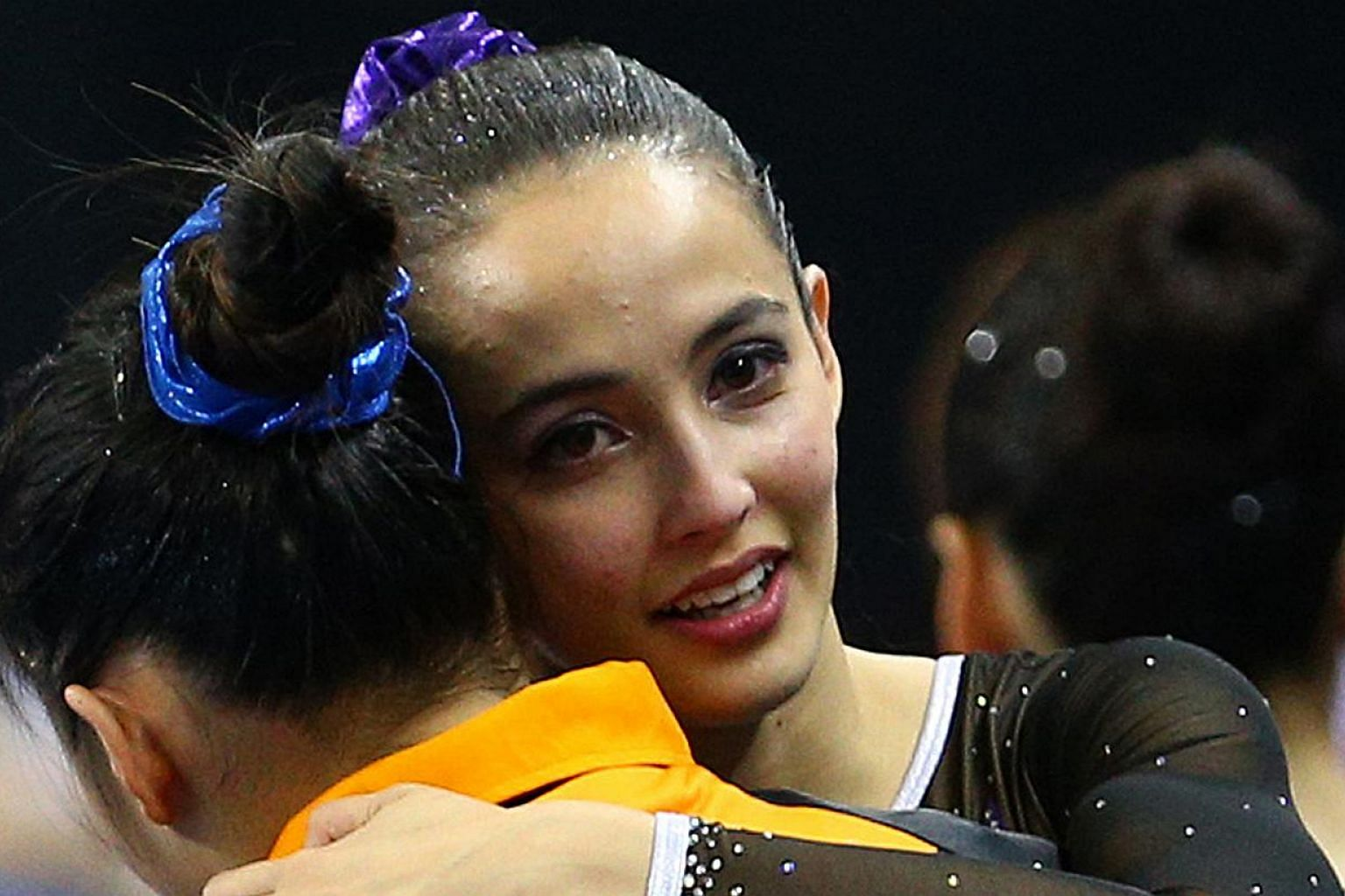 Malaysian gymnast Farah Ann Abdul Hadi (right) recently came under fire from netizens who criticised her competition attire during the SEA Games in Singapore. -- PHOTO: SINGAPORE SEA GAMES ORGANISING COMMITTEE/ACTION IMAGES VIA REUTERS
