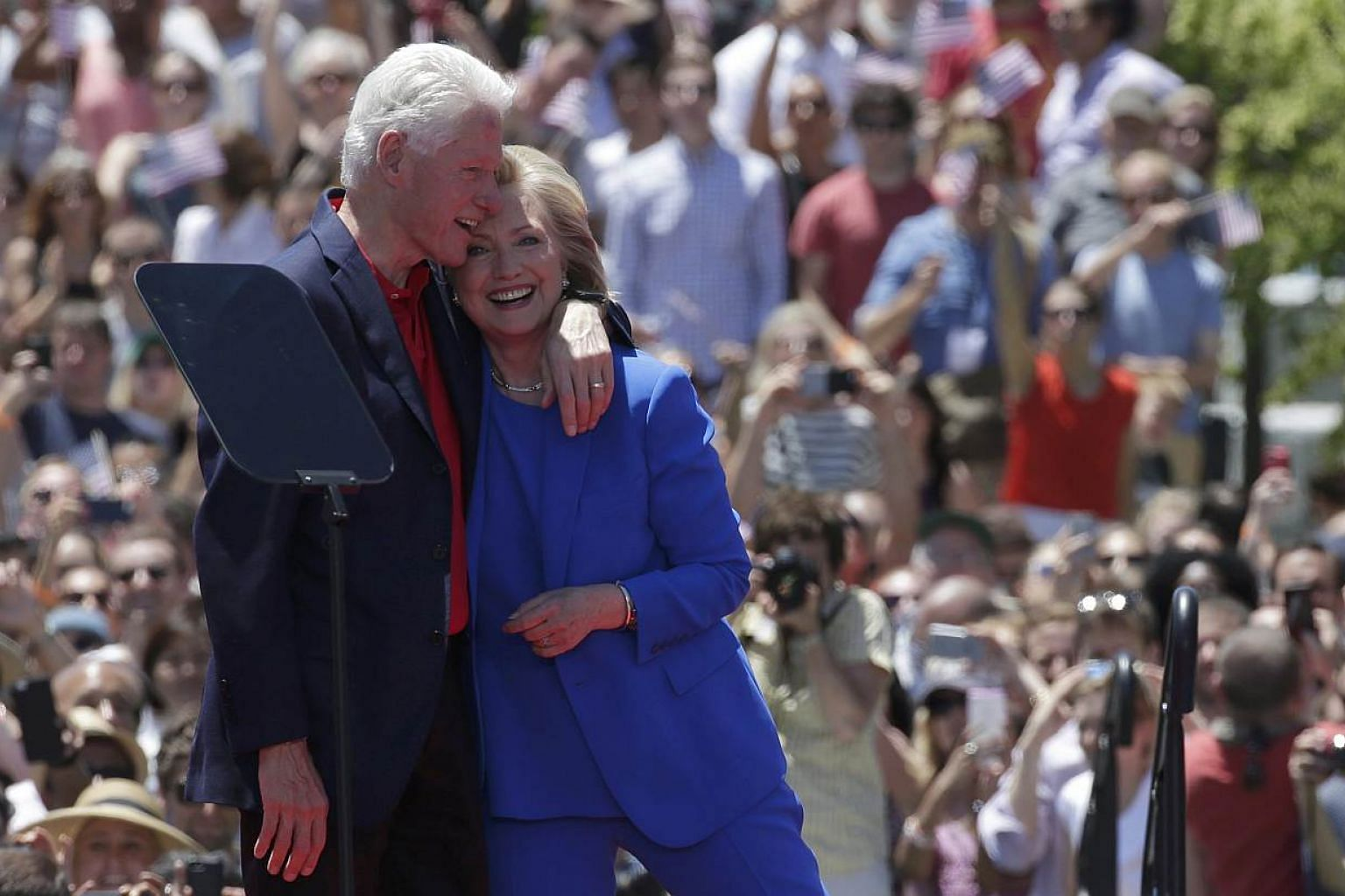 "US Democratic presidential candidate Hillary Clinton is embraced by her husband, former president Bill Clinton, after she delivered her ""official launch speech"" at a campaign kick-off rally in Franklin D. Roosevelt Four Freedoms Park on Roosevelt Isl"