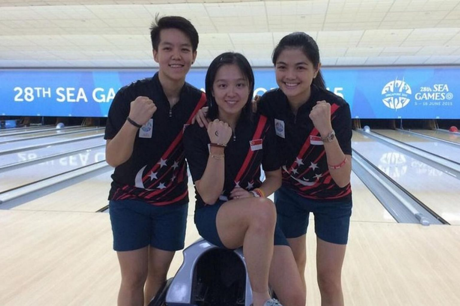 A fourth bowling gold medal for Singapore is guaranteed after keglers (from left) Shayna Ng, Jazreel Tan and Daphne Tan filled all three stops in the women's stepladder finals on June 14, 2015. -- ST PHOTO: JONATHAN WONG