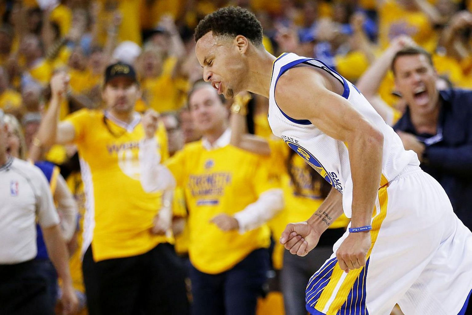 Stephen Curry of the Golden State Warriors celebrates in the second quarter against the Cleveland Cavaliers during Game Five of the 2015 NBA Finals at the Oracle Arena on June 14, 2015 in Oakland, California. -- PHOTO: AFP