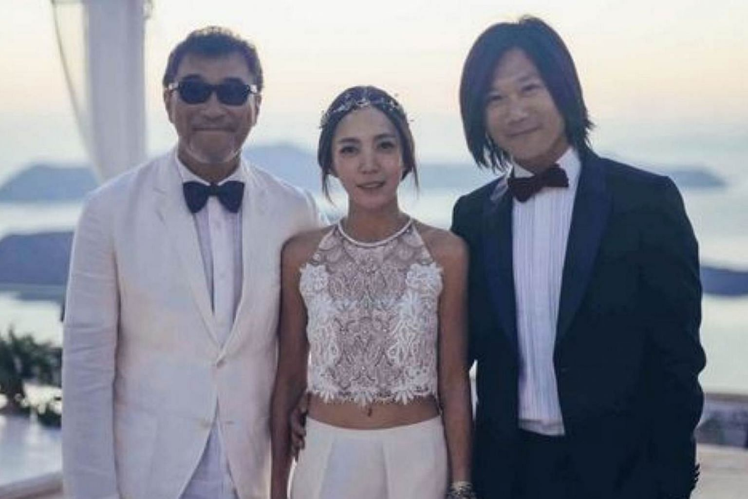 Singer-songwriter Jonathan Lee (left) with Mayday bassist Masa (right) and his new bride Vicky Hsieh. --PHOTO: B'IN MUSIC