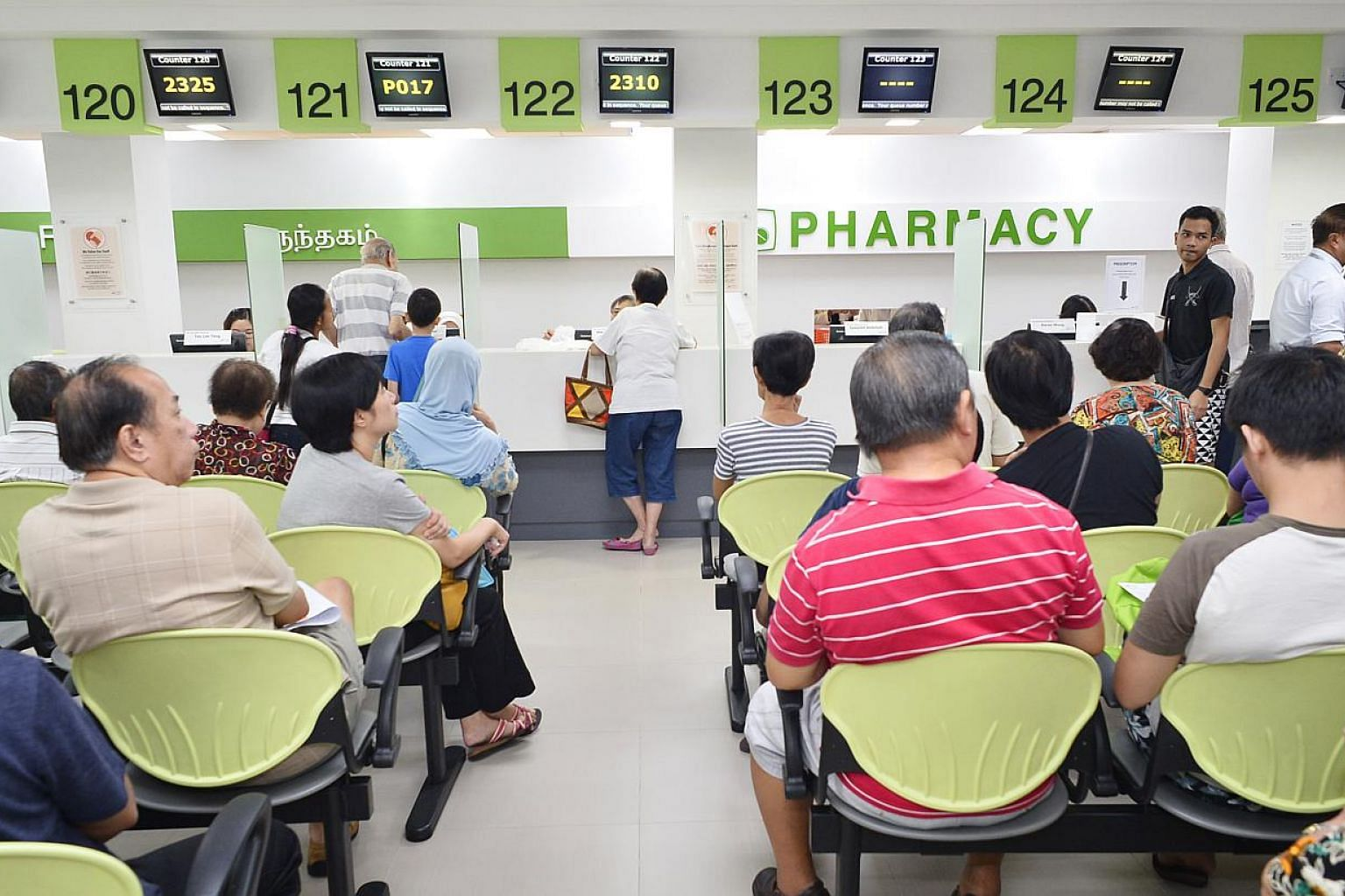 Patients waiting for their medicine at the pharmacy of Tampines Polyclinic. Singaporean households who received MediShield Life letters with a deadline indicated are encouraged to confirm and update their household information by June 19, says the Mi