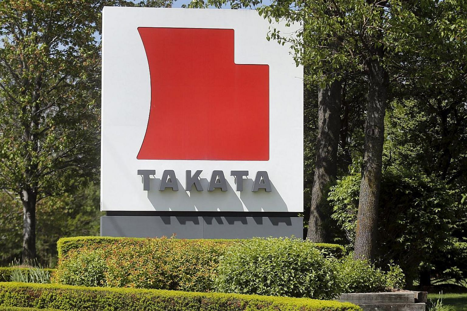 A sign with the Takata logo is seen along the driveway leading to the Takata Corporation building in Auburn Hills, Michigan, in this May 20, 2015 file photograph. -- PHOTO: REUTERS