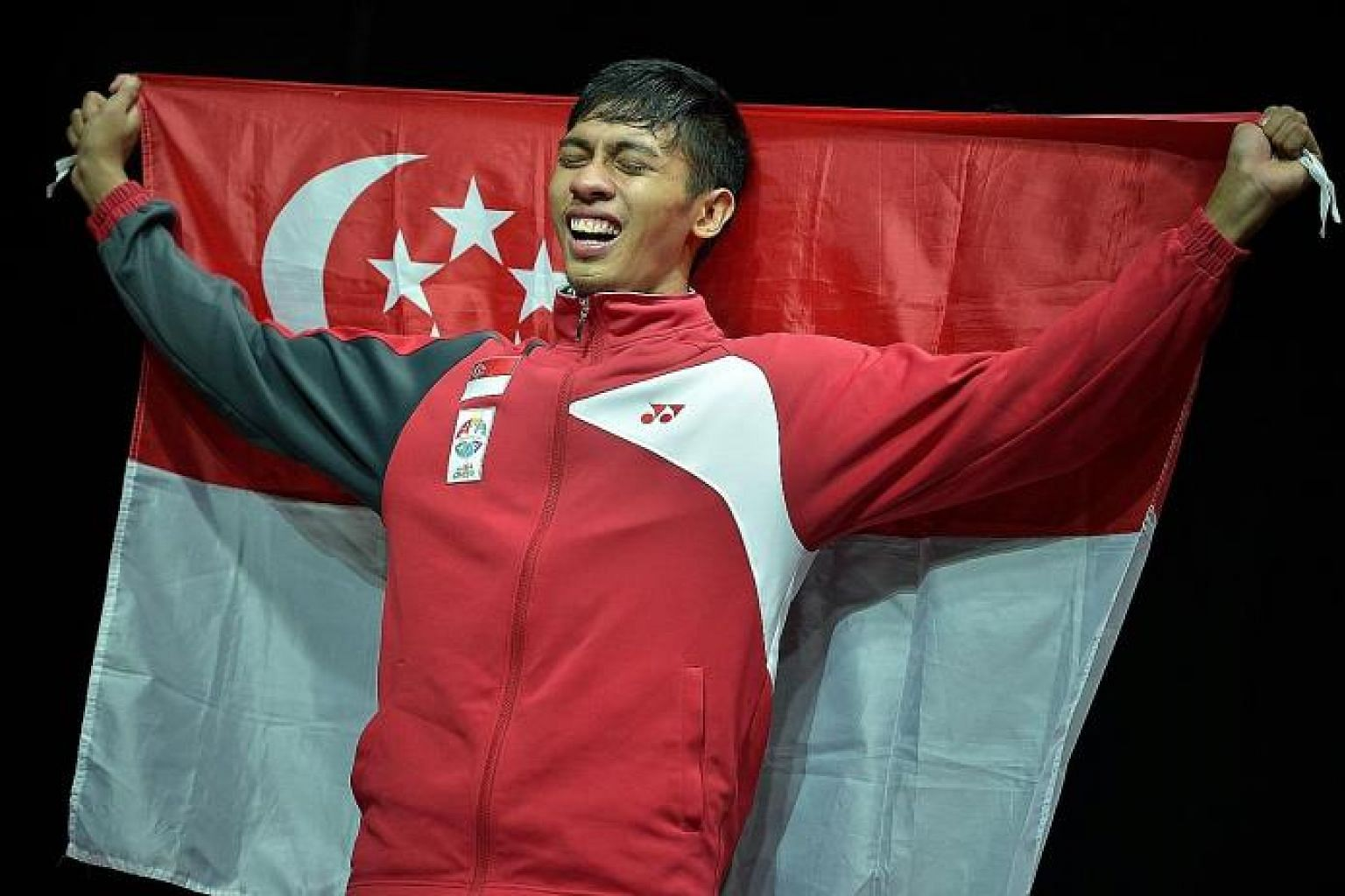 Silat fighter Muhammad Nur Alfian Juma'en crying at the medal ceremony after winning gold in the men's tanding F Class. His gold was the only win for silat - a win that mattered greatly to the sport, the fans and him.