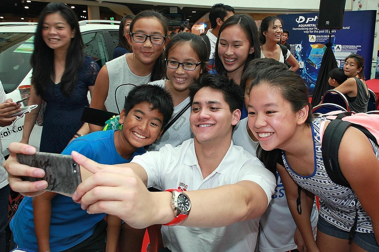 "Singapore swim star Joseph Schooling takes a ""wefie"" with his fans at the launch of the Fina World Junior Championships in Singapore. The 20-year-old, who won nine golds at the just-concluded SEA Games, is the local ambassador for the Aug 25-30 event"