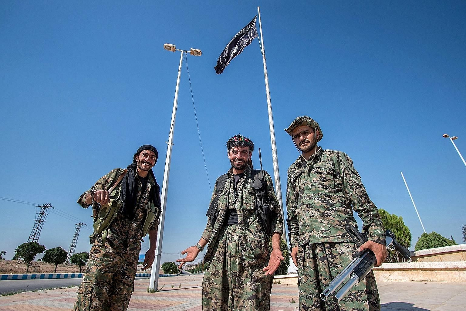 Kurdish People's Protection Units (YPG) fighters in Tal Abyad on the Turkish border. The Kurds retook the key hub this month, one in a string of victories over the jihadists who have been sweeping through the area.