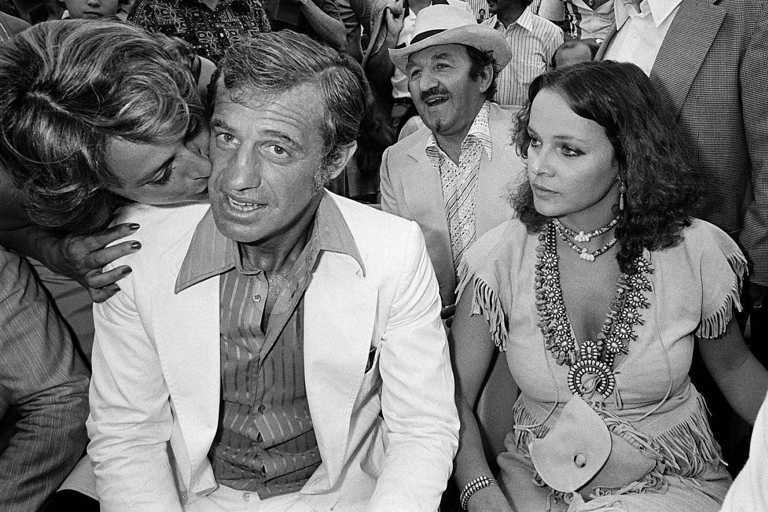 Jean-Paul Belmondo (second from far left), one of France's biggest screen stars, and Italian actress Laura Antonelli (left) in a 1976 photo.