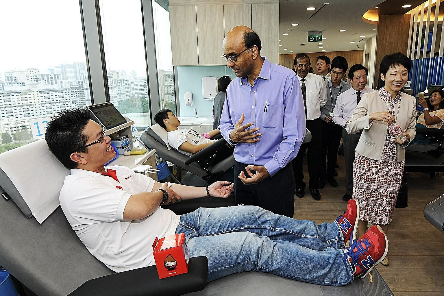 Deputy Prime Minister Tharman Shanmugaratnam, accompanied by Minister in the Prime Minister's Office Grace Fu, meeting blood donors at the opening of Bloodbank@Westgate Tower yesterday.