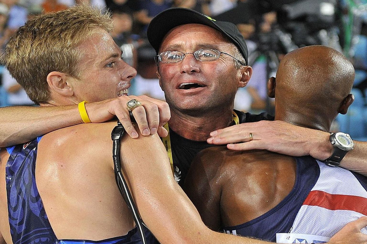 Coach Alberto Salazar, hugging winner Mo Farah (right) and Galen Rupp after the 5,000m final at the 2011 World Championships in Daegu in South Korea, is alleged to have given Rupp testosterone when the athlete was just 16 years old.