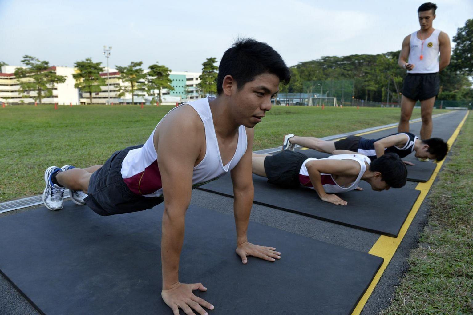 NSmen doing push-ups at Maju Camp.
