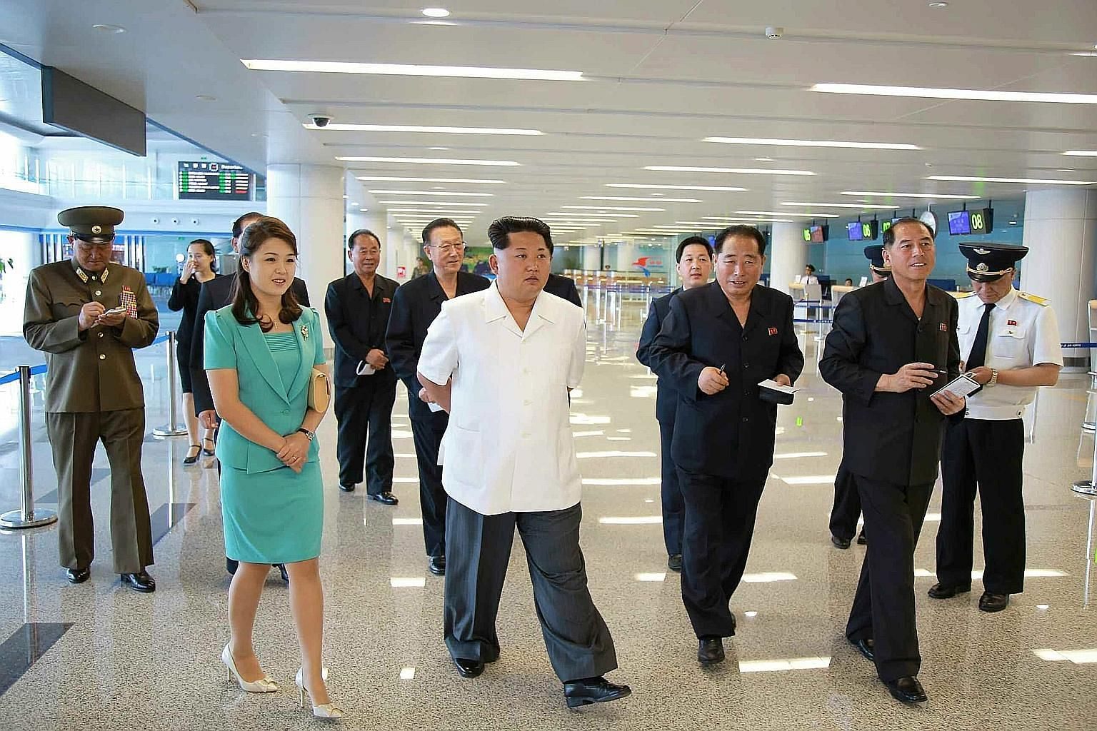 Pictures released yesterday by the Rodong Sinmun newspaper show North Korean leader Kim Jong Un (centre) and his wife, Ms Ri Sol Ju, inspecting the new terminal (below) at Pyongyang International Airport.