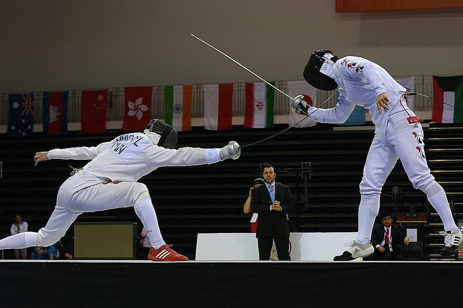 The unheralded world No. 107 from China, Jiao Yunlong, lunging to score a point in his razor-thin 11-10 win over the highest-ranked fencer in the epee discipline, world No. 6 Park Kyoung Doo from South Korea.