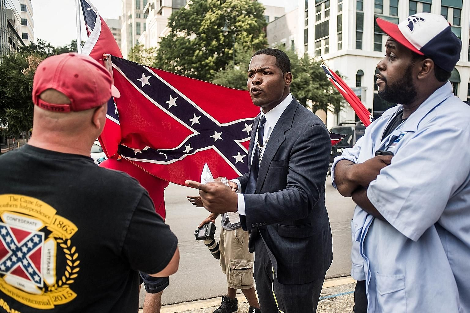 A scene outside the South Carolina State House on Tuesday. The Confederate banner was originally raised atop the building in 1961 in what was described as a commemoration of the centennial of the Civil War. Others, however, saw it as a slap in the fa