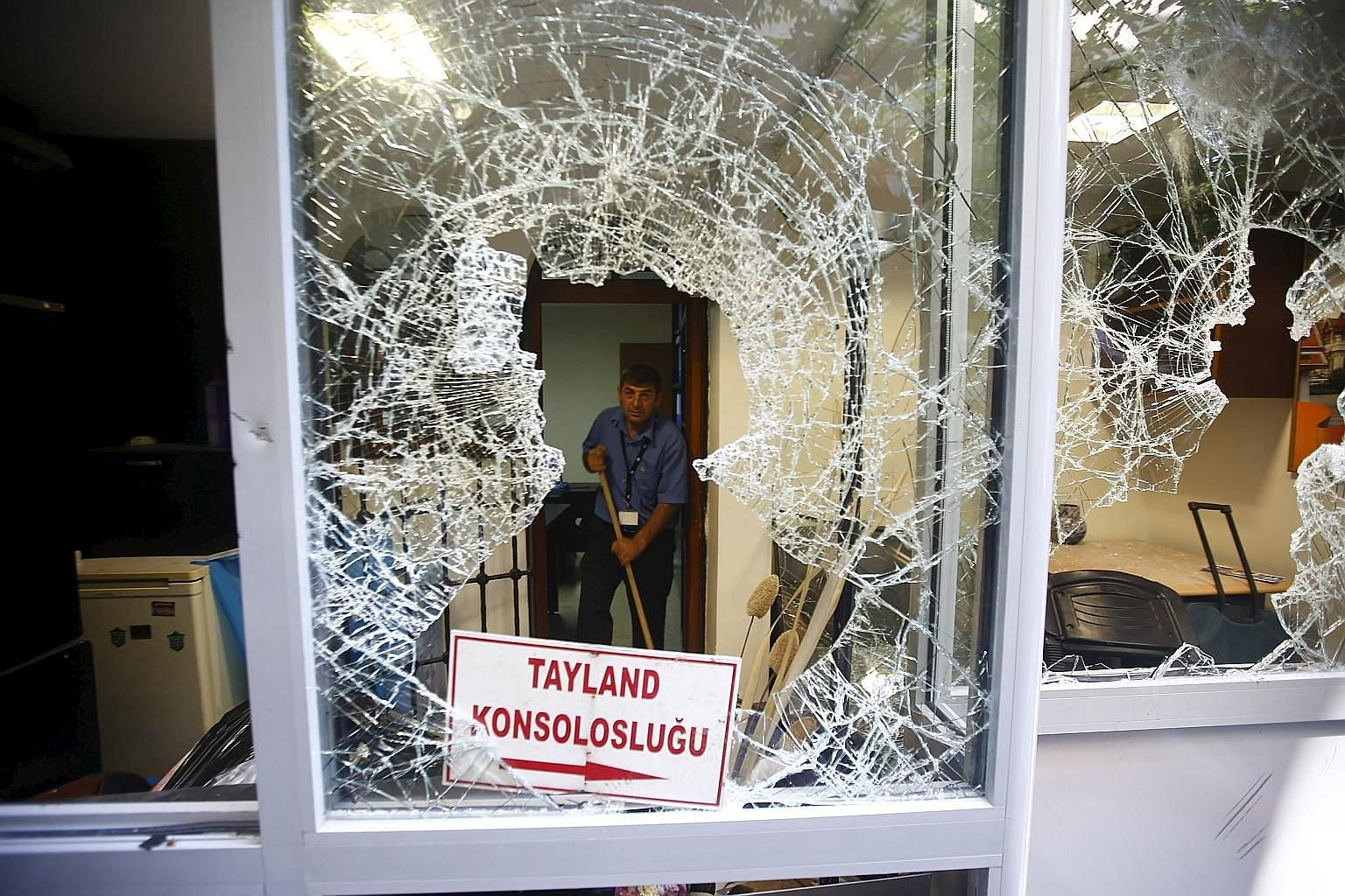 A broken window of the Thai honorary consulate after an attack this week in Istanbul.