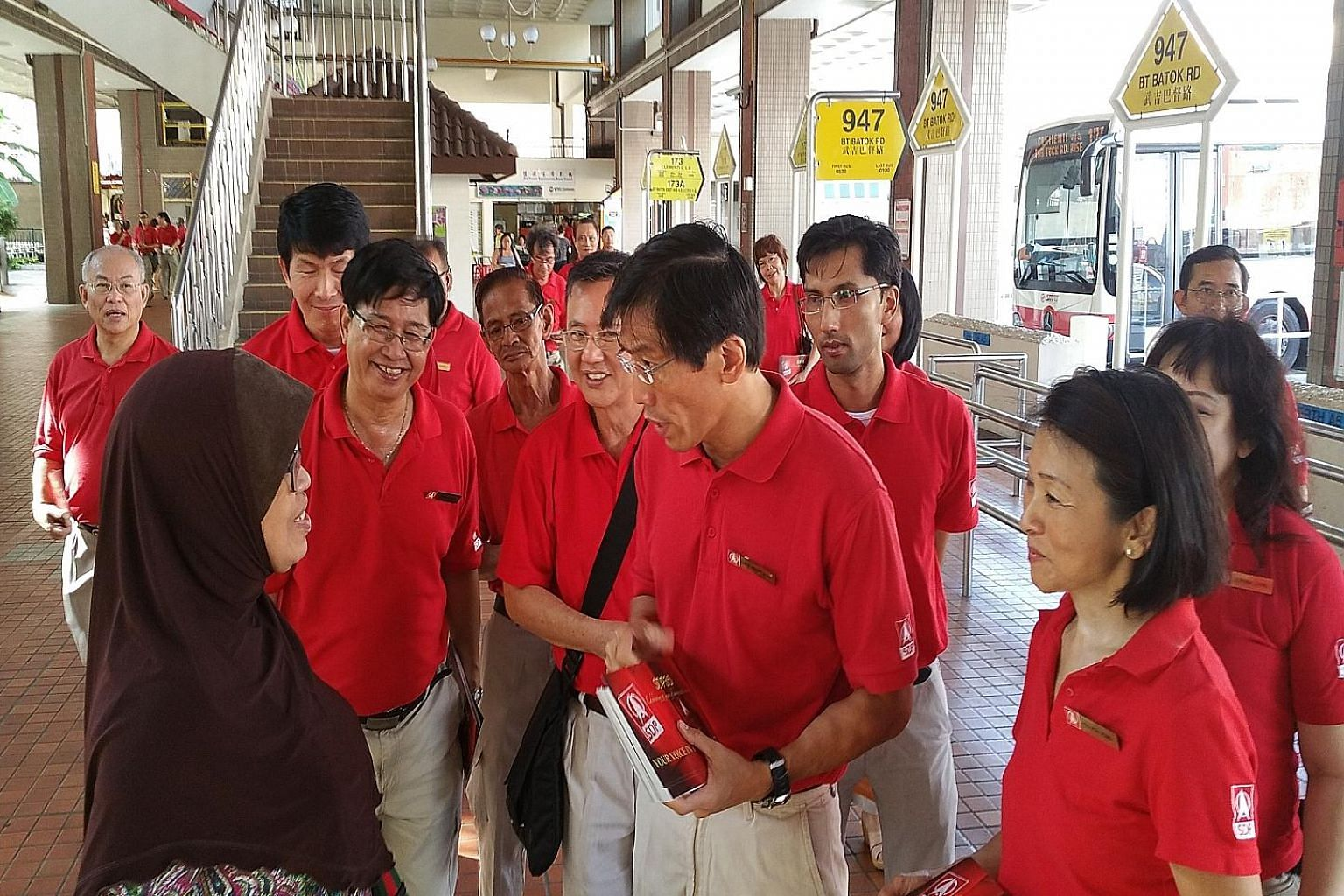 SDP secretary-general Chee Soon Juan (centre) leading party members and activists on a walkabout in Bukit Batok yesterday. The party is also contesting areas where it stood in the 2011 General Election.